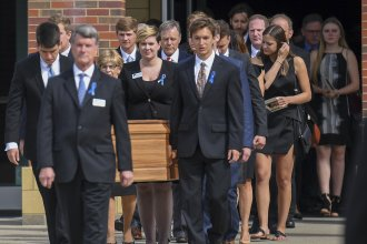 Mourners carry the coffin of Otto Warmbier after his funeral Thursday. The funeral was held at Wyoming High School, outside Cincinnati.