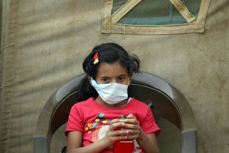 A Yemeni child suspected of having cholera sits outside a makeshift hospital in the capital, Sanaa, earlier this month. World health authorities say that of the more than 1,300 people who have died of the disease, a quarter have been children.