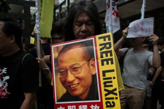 Chinese dissident Liu Xiaobo, whose image is seen here during during a pro-democracy protest in Hong Kong last year, has been granted medical parole.