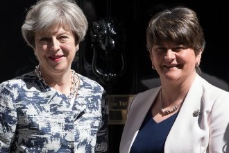 British Prime Minister Theresa May (left) greets Arlene Foster, leader of Northern Ireland's Democratic Unionist Party, outside 10 Downing St. in London on Monday.