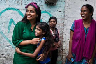 UNICEF Global Goodwill Ambassador and YouTube personality Lilly Singh meets children supported by the U.N. agency in Nagar, India, in July.