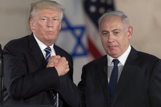 President Trump and Israeli Prime Minister Benjamin Netanyahu shake hands in Jerusalem in May. Some critics say Netanyahu responded cautiously to the Charlottesville rally because he wanted to avoid angering Trump.