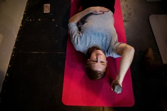 """Vanessa Wauchope begins abdominal exercises in Leah Keller's class in San Francisco, Calif. Keller teaches an exercise, called """"drawing in,"""" to help strengthen abdominal muscles that tend to spread apart a bit during pregnancy."""