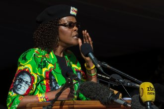 South Africa granted diplomatic immunity to Zimbabwean first lady Grace Mugabe after she was accused of assaulting a young woman at a Johannesburg hotel. Above, Mugabe addresses a youth rally in June.