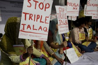 """Activists hold signs during a protest against """"triple talaq,"""" the practice of instant divorce by Muslim men, in New Delhi on May 10. The country's Supreme Court has overruled the law permitting triple talaq."""