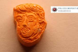 This photograph provided by Osnabrück police shows one of the ecstasy pills they seized over Saturday evening. In all, the heap of pills shaped like Donald Trump's head had an estimated street value of nearly $46,000.