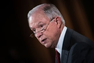 "Attorney General Jeff Sessions speaks at the Department of Justice on Aug. 4. The department is being sued by multiple cities, including now Los Angeles, over its stance on ""sanctuary cities."""