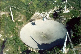 Until it was surpassed recently by a similar instrument in China, the Arecibo radio telescope in Puerto Rico, completed in 1963, was the world's single largest.