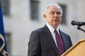 Attorney General Jeff Sessions speaks during a vigil ceremony marking the Sept. 11 terrorist attacks at the Department of Justice.