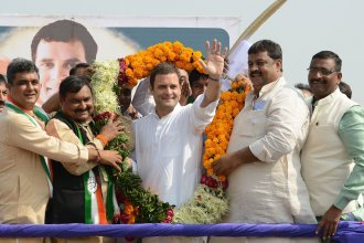 Vice president of the Indian National Congress Party Rahul Gandhi (center) waves while being garlanded during a political rally at Chilloda village on Nov. 11. Gandhi takes over the party leadership this week from his mother, Sonia Gandhi, who is stepping down because of health concerns.