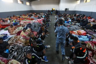 African migrants sitting in a shelter at the Tariq Al-Matar migrant detention center on the outskirts of the Libyan capital Tripoli, on Monday.
