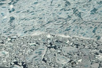 Melt ponds dot a stretch of sea ice in the Arctic Ocean, north of Greenland. This year was the Arctic's second-warmest in at least 1,500 years, after 2016.