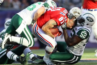 Aaron Hernandez (81), of the New England Patriots, lost his helmet during this play against the New York Jets in 2011. Hernandez killed himself in 2017, and researchers found that he had had one of the most severe cases of CTE ever seen in someone his age.