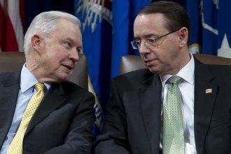 Attorney General Jeff Sessions speaks with Deputy Attorney General Rod Rosenstein at an event at the Department of Justice in Washington, D.C. on Feb. 2, 2018.