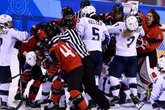 The U.S. women are facing Canada in a gold medal match iat the Pyeongchang Winter Olympics. In their preliminary round match, players piled up in a scrum around the Canadian goal.