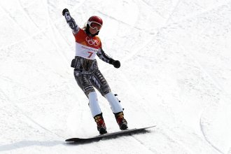 Ester Ledecka of the Czech Republic celebrates winning gold in the ladies' snowboard parallel giant slalom at the Pyeongchang Olympic Games Saturday.