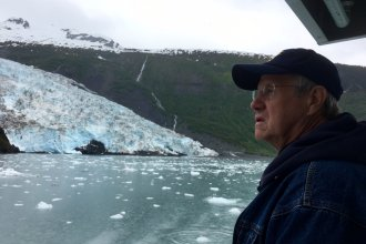 Commentator Rex Buchanan views glaciers during a recent trip to Alaska. (Photo by Mindy James)