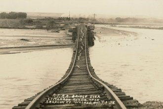 This is a postcard showing the Chicago, Rock Island & Pacific Railroad bridge over the Cimarron River during the flood of 1938. The bridge is near Arkalon, Kan., and was soon replaced with the Samson of the Cimarron, which was completed in 1939. (Photo Courtesy of kansasmemory.org / Kansas Historical Society)