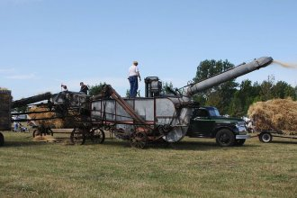 A threshing machine in operation. (Photo from Wikipedia)
