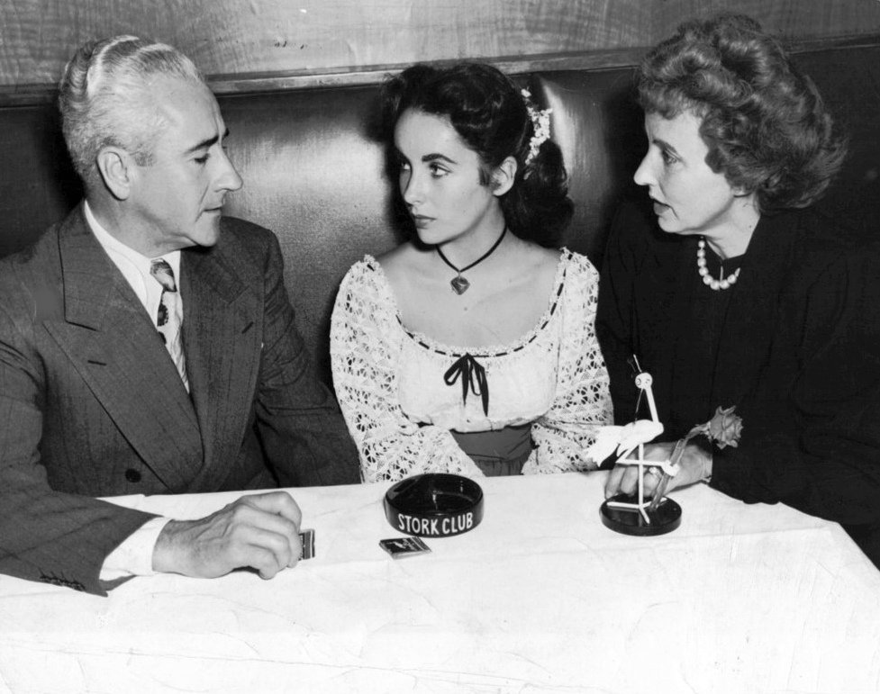 Elizabeth Taylor with her parents at the Stork Club in New York in 1947. (Photo via Wikimedia)