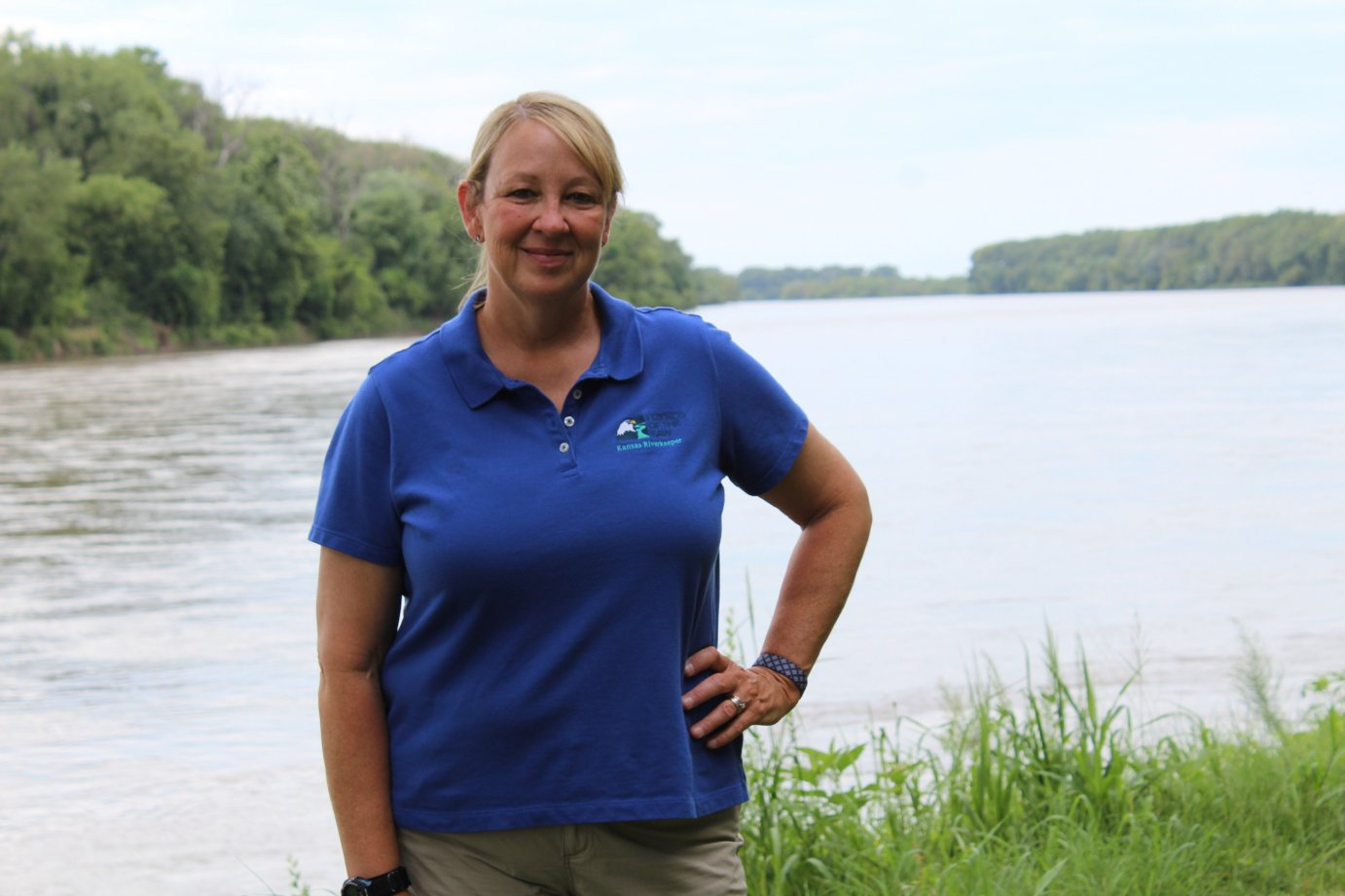 Kansas River Keeper Dawn Buehler stands along the banks of the Kaw in North Lawrence. The DeSoto resident was part of a seven member team that paddled the entire 173-mile length of the Kansas River this summer.  (Photo by J. Schafer)