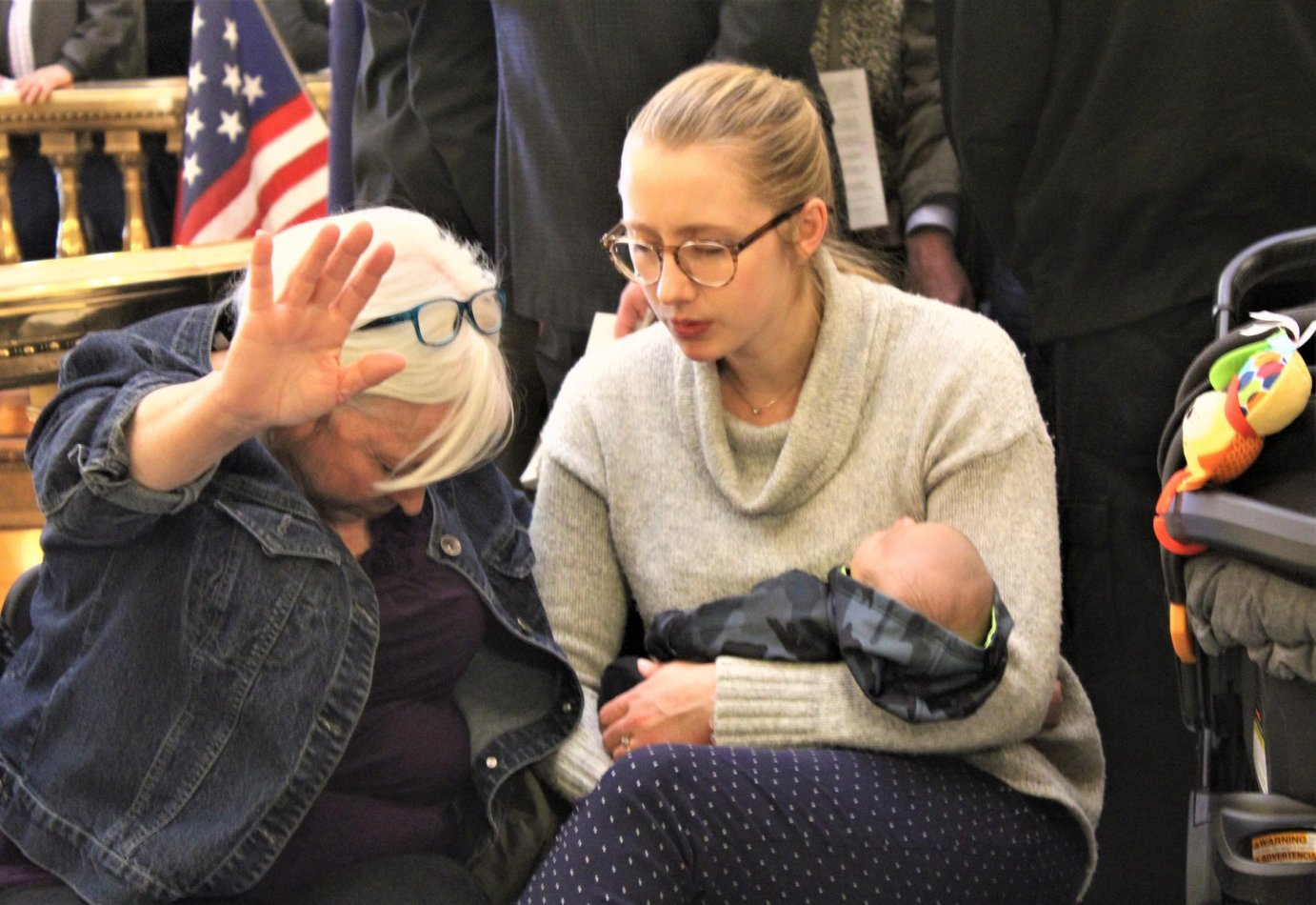 Abortion protestors this year in Topeka, where Medicaid expansion and an anti-abortion amendment to the state constitution have become entagled. (Photo by Jim McLean, Kansas News Service)