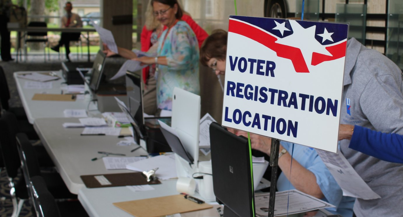Volunteers with the League of Women Voters running a voter registration drive in Topeka. (Photo by Stephen Koranda)