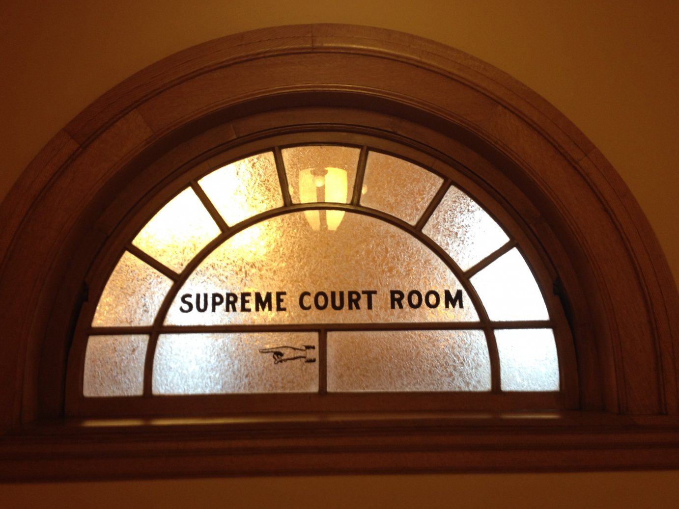A window to the old Kansas Supreme Court room in the Kansas Statehouse.  The high court now resides across the street from the Statehouse, inside the Kansas Judicial Center.  (Photo by J. Schafer)