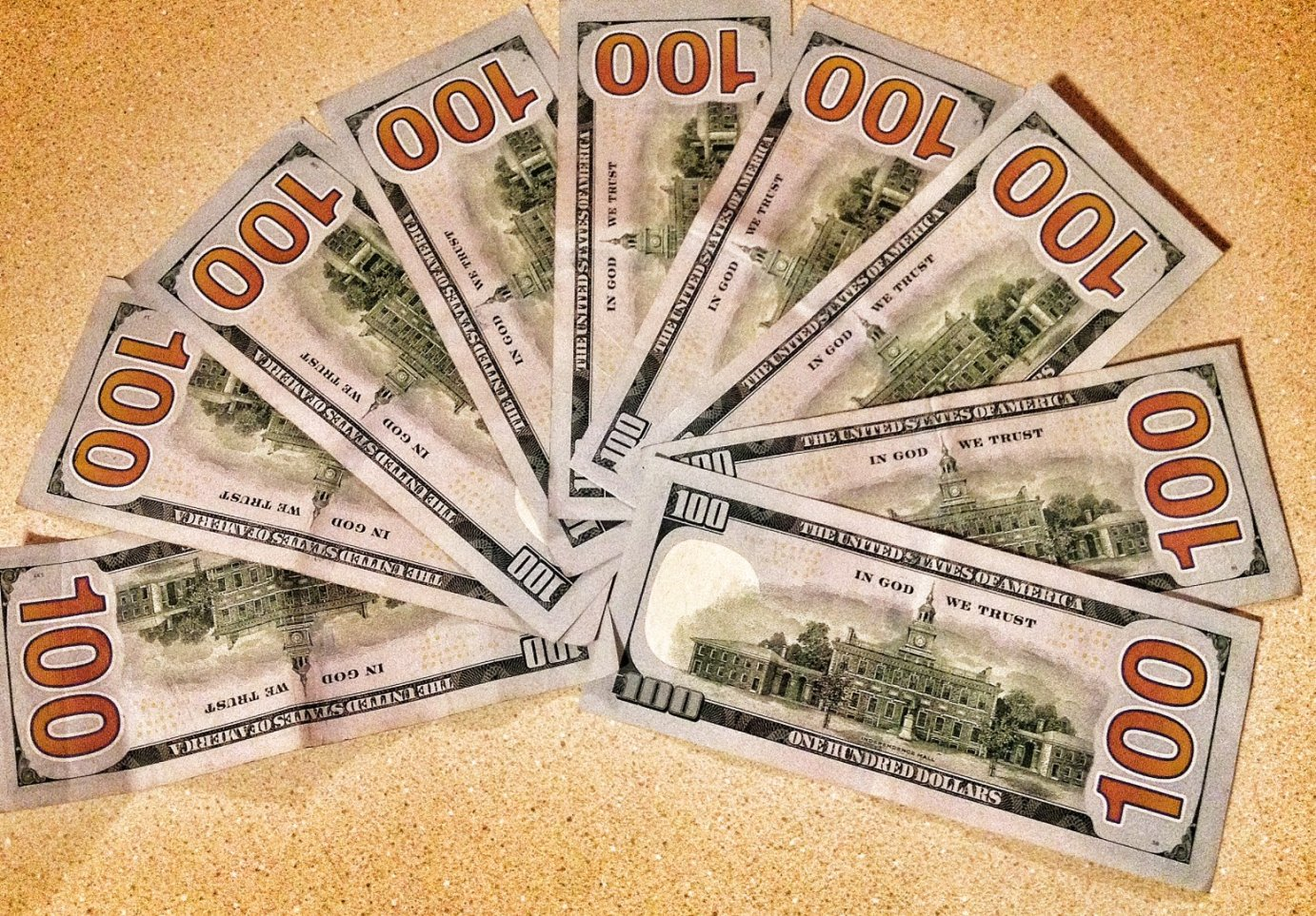 Assortment of $100 bills.  The Kansas Treasury needs to collect many, many more of these so the state can pay its bills. (Photo by J. Schafer)