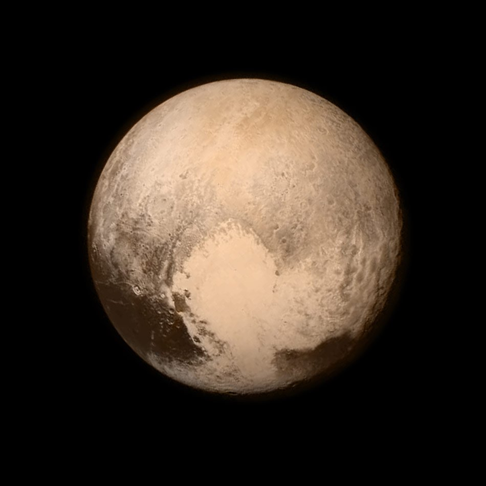 """A heart-shaped image appears on the surface on Pluto in this new photo released by NASA.  NASA calls it a """"love letter"""" from Pluto to Earth."""