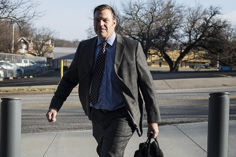 Kansas Secretary of State Kris Kobach outside a federal courthouse during a trial over his handling of voter registration earlier this year. (Kansas News Service file photo)