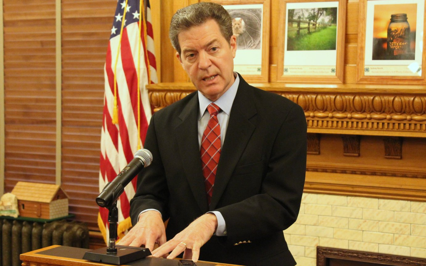 Governor Sam Brownback speaking to reporters last month. (Photo by Stephen Koranda)