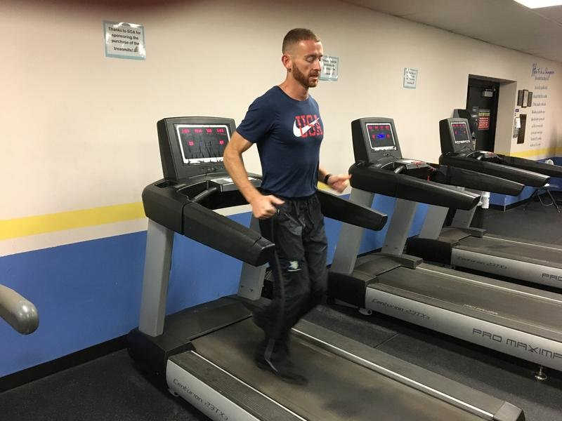 Aaron Yoder practices for the international backward-running championships at Bethany College in Lindsborg, Kansas.  (Photo by Greg Echlin)