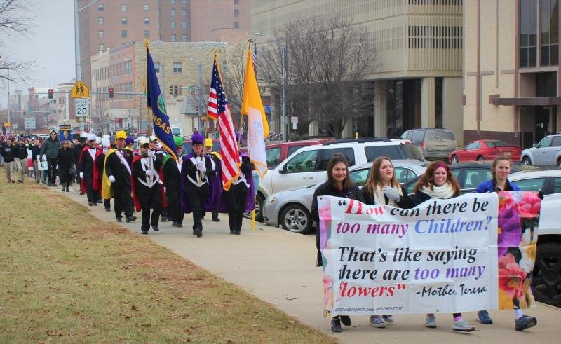 Anti-abortion protesters march around the Kansas Statehouse in 2017. (Photo by Stephen Koranda / Kansas Public Radio)