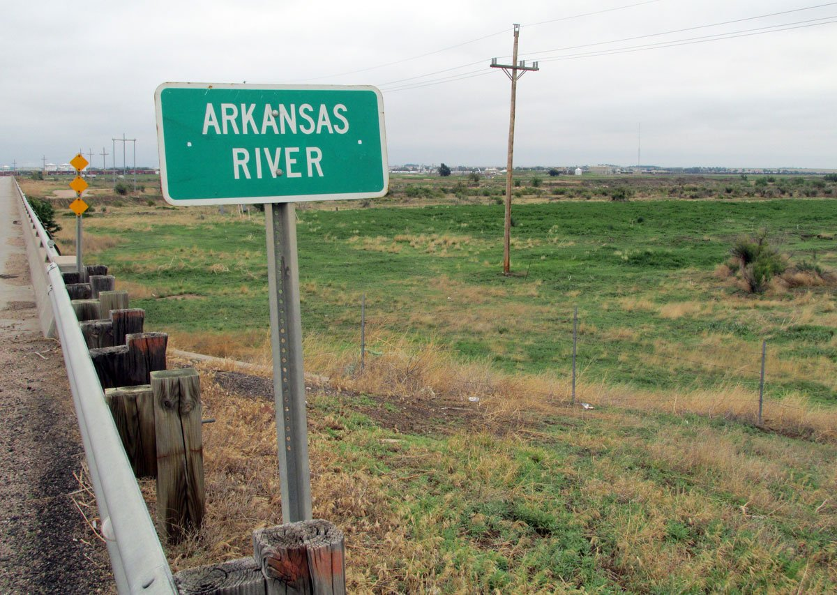 The Arkansas River bridge, just one mile south of Garden City on U.S. 83, sits over a parched riverbed where the river once ran. (Photo by David Guth)