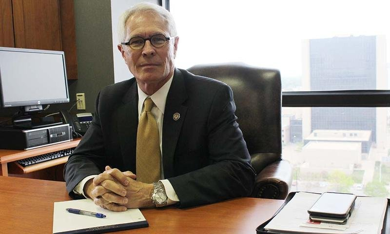 U.S. Attorney for Kansas Barry Grissom sits in his Wichita office this week, just prior to stepping down from his post.  Grissom is taking a job with a private law firm in Kansas City.  (Photo by Sean Sandefur, KMUW Radio)