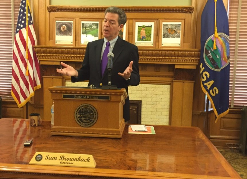Governor Brownback said in a news conference that Hillary Clinton is deepening racial divides. (Photo: Jim McLean)
