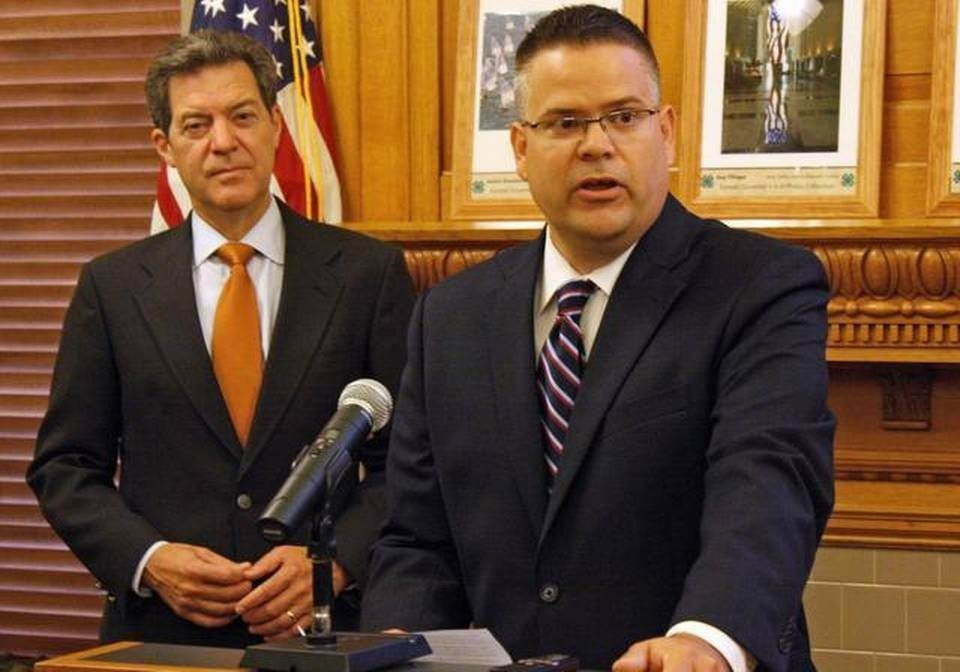 Governor Sam Brownback and Caleb Stegall (Photo credit: Associated Press)