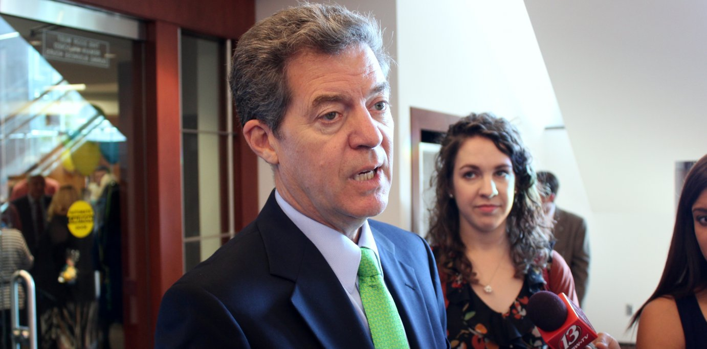 Governor Brownback speaking to reporters this week. (Photo by Stephen Koranda)
