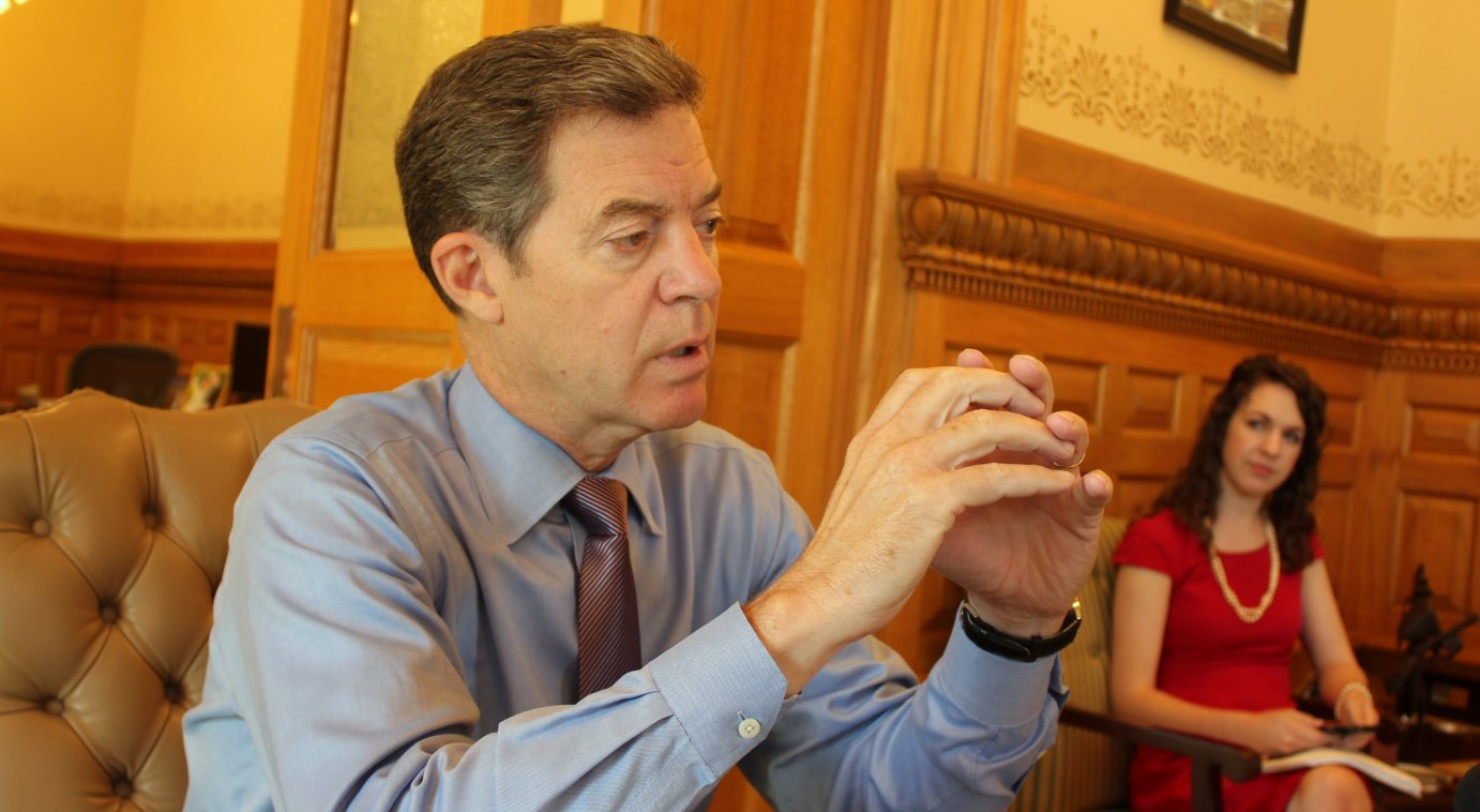 Governor Brownback speaking to reporters Monday. (Photo by Stephen Koranda)