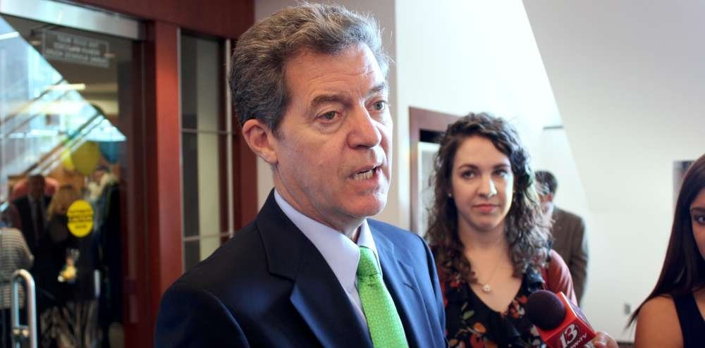 Governor Brownback speaking to reporters earlier this month. (Photo by Stephen Koranda)