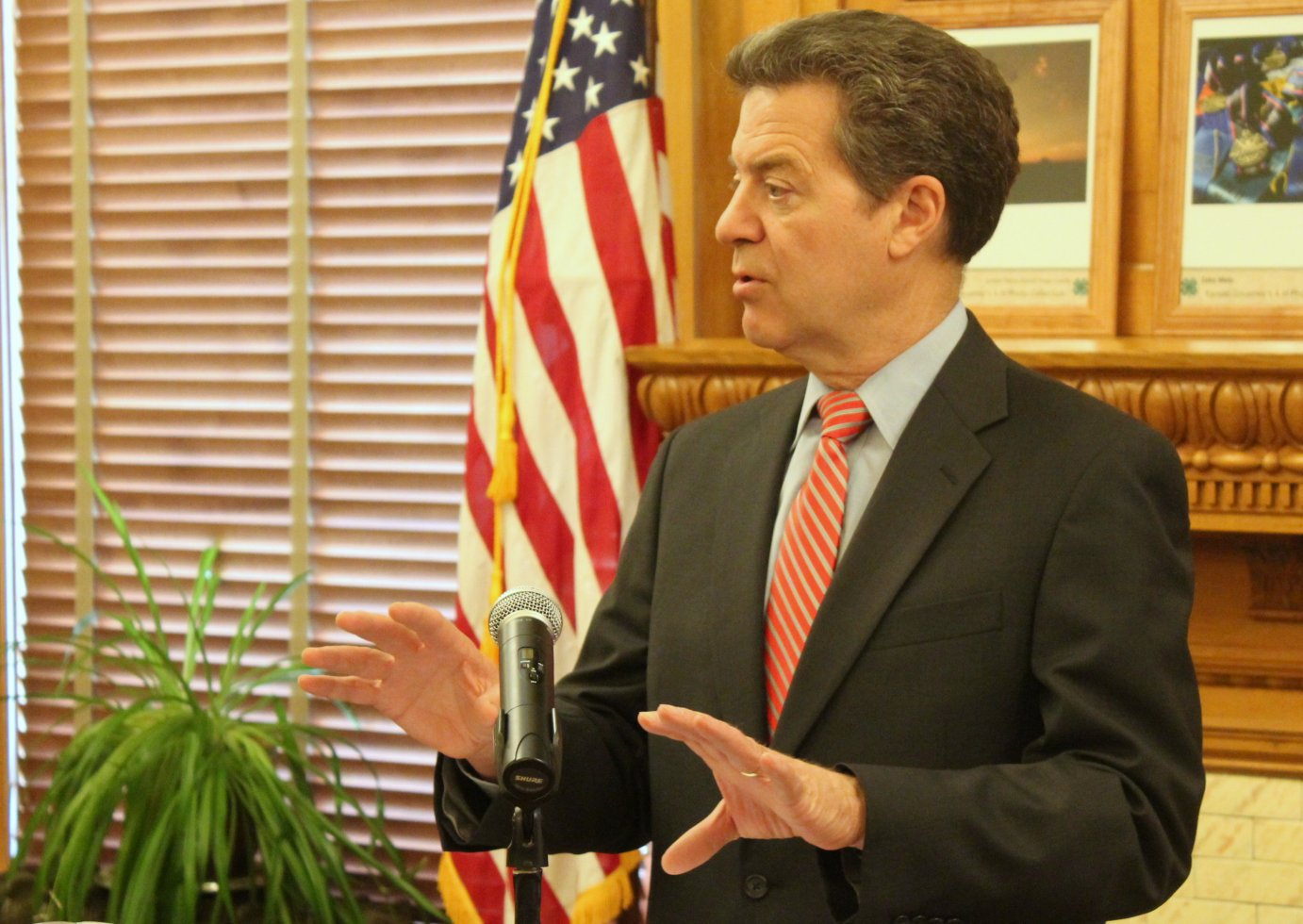 Brownback during a press conference last month. (Photo by Stephen Koranda)