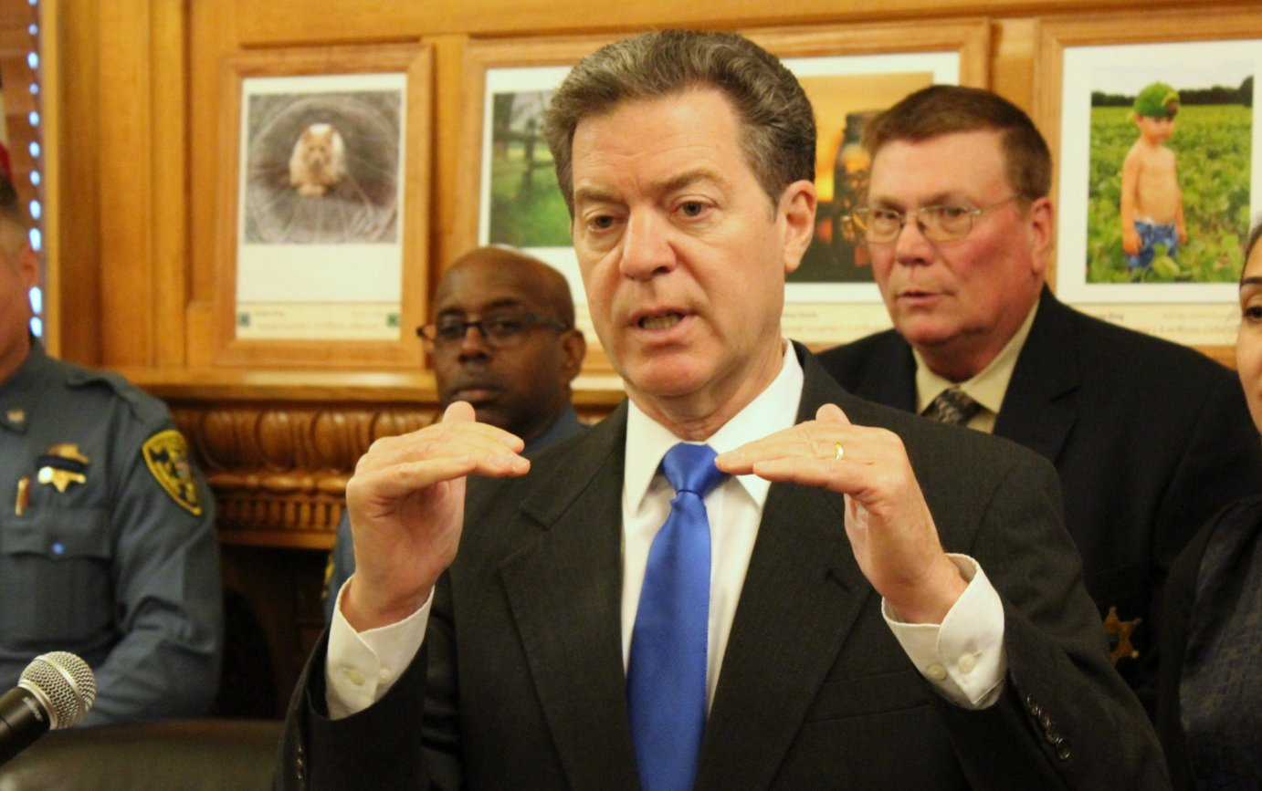 Governor Sam Brownback speaking to reporters last week. (Photo by Stephen Koranda)