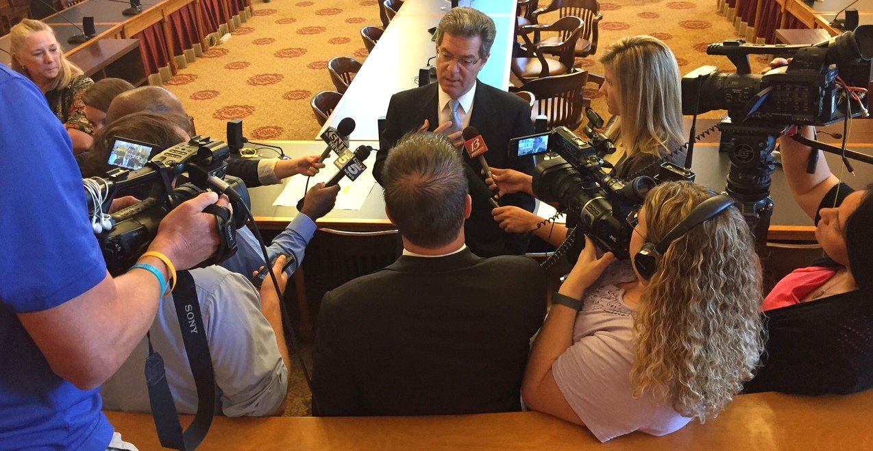 Governor Brownback talks to reporters after the meeting. (Photo by Stephen Koranda)
