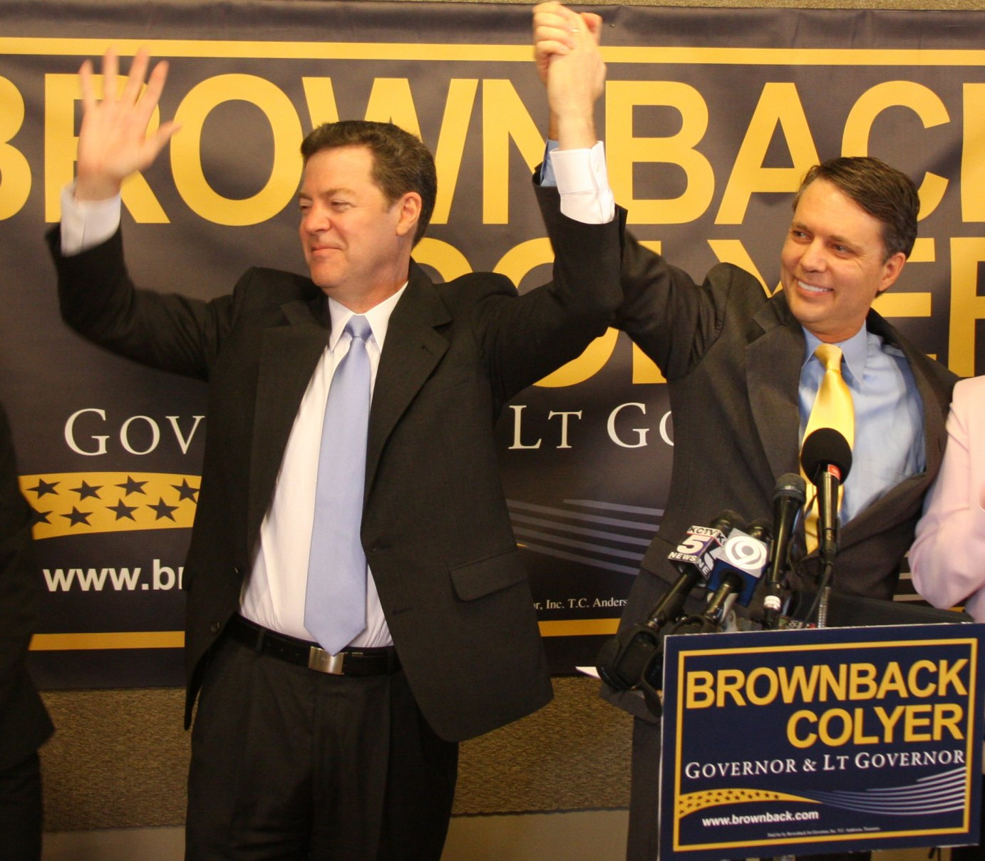 Governor Sam Brownback and Lt. Governor Jeff Colyer on the campaign trail. (AP file photo)