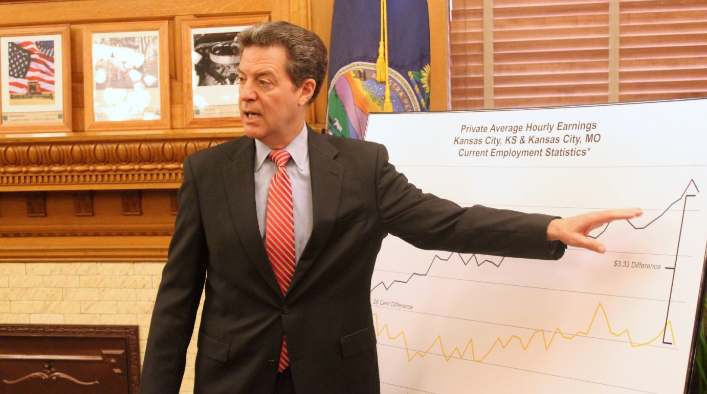 Brownback speaks to reporters during a news conference. (Photo by Stephen Koranda)