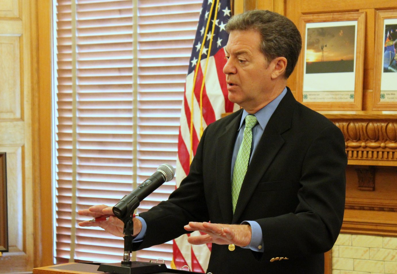 Brownback speaking to reporters last month. (Photo by Stephen Koranda)