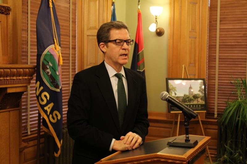 "Governor Sam Brownback touted his administration's policies — including reinstating a work requirement for food stamp recipients — as an alternative to what he described as a series of failed welfare policies dating back to President Lyndon B. Johnson's ""war on poverty"" in the mid-1960s.  (Photo by Andy Marson, KHI News Service)"
