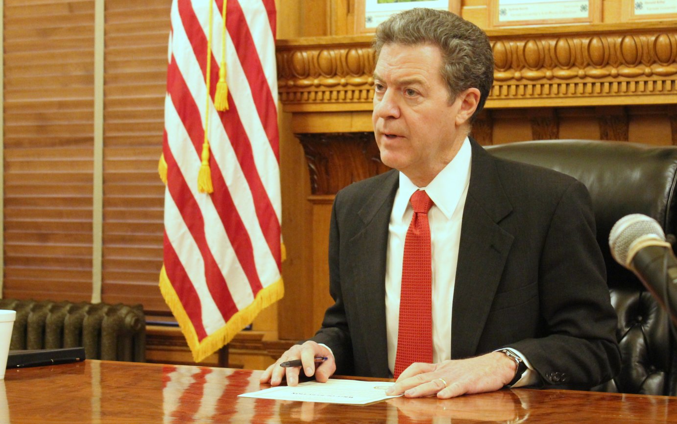 Governor Sam Brownback at a ceremony setting the special election date. (Photo by Stephen Koranda)