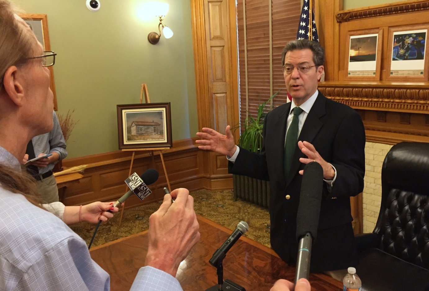 Governor Brownback speaking to reporters last month. (Photo by Stephen Koranda)